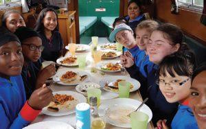 Children enjoying lunch on the Angel Boat