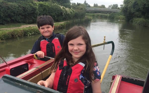 Children steering the canal boat